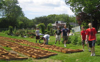 Eagle Scouts volunteers filling green roof trays 346x215